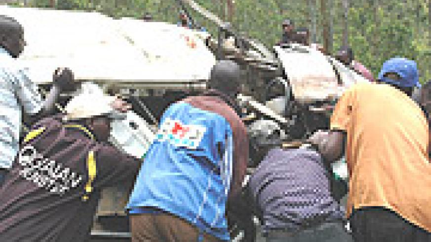 Speed kills: Local rescue team helping the injured and removing dead bodies from a taxi wreckage.