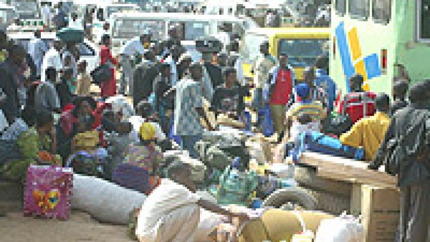 TIME TO GO HOME : People stranded at Nyabugogo main taxi park on their way home for Christmas. (Photo/ G.Barya)