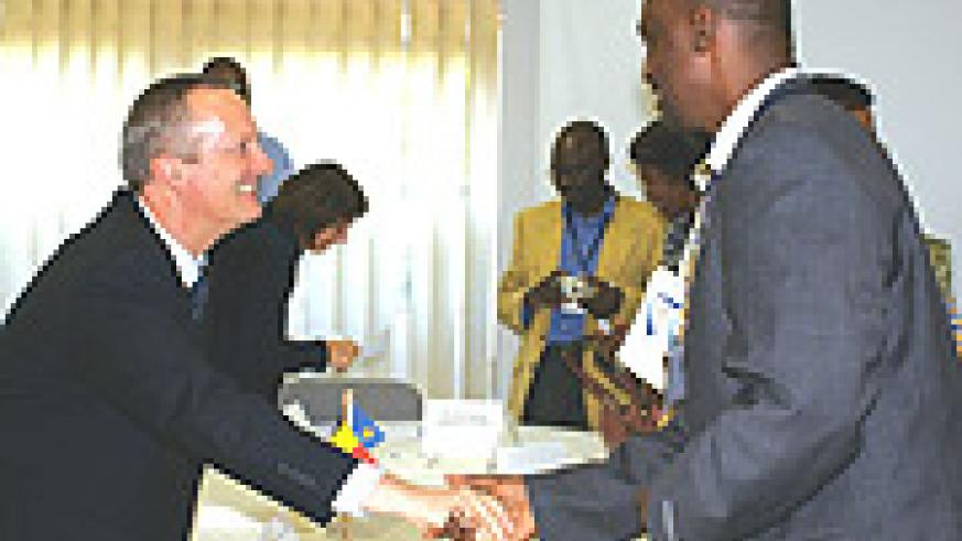 Belgian Ambassador Ivo Goemans shaking hands with a representative of one of the NGOs that signed the agreement. (Courtsey Photo)