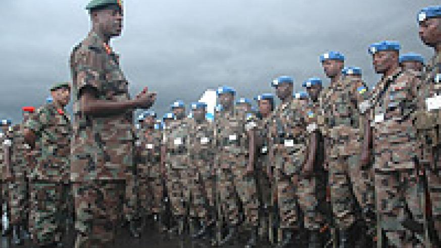 CDS, Gen.James  Kabarebe addresses the last batch of the 51st bn troops on their arrival from Darfur at Kigali International Airport. (Photo J Mbanda).