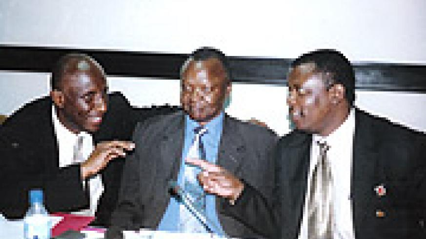 NEW AND OLD: Leodgar Chilla Tenga (L) and his predecessor Denis Obua (C) with Cecafa's  Nicholas Musonye share a light moment after last year's congress.