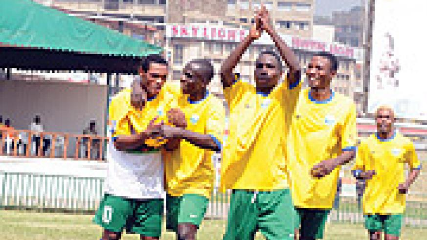 RECOVERED: Amavubi Stars players congratulate Bokota Labama upon scoring the team's third goal against Somalia
