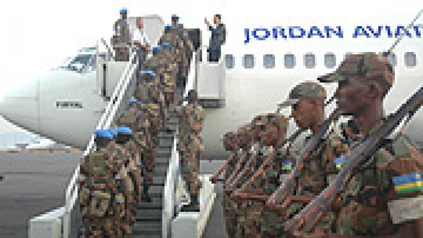 RDF peacekeepers boarding a plane to Darfur. (File Photo).