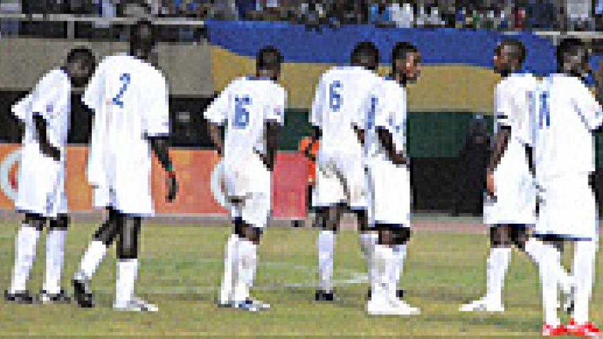 BROKEN HEARTS: Dejected Rwanda players look on after conceding the third goal in their first game against Uganda. Rwanda was pinned to the last semifinal place by Tanzania last night.Uganda beat Tanzania 2-1 . (Photo / A. E. ORYADA)