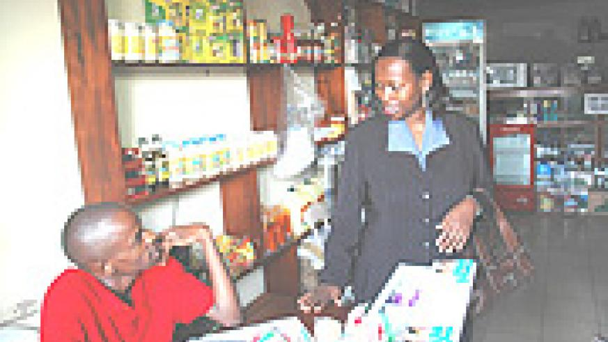 Commerce Minister Monique Nsanzabaganwa talks to a shop attendant during the recent inspection. (Photo J Mbanda).