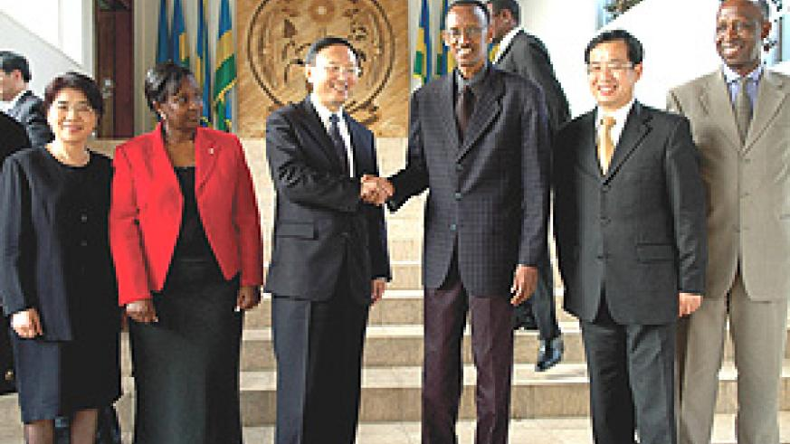 Chinese Foreign Minister Yang Jiechi shakes hands with President Paul Kagame after the former's courtesy call on the President at Urugwiro Village yesterday. (PPU Photo).