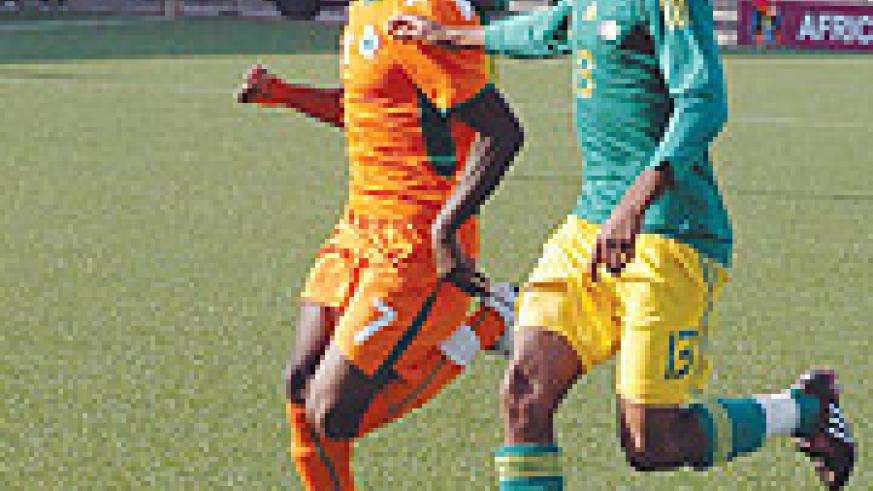 Tussling it out; South Africa's Matuka Thabang and Ivory Coast's N'gossan Antoine Jean battle for the ball in Yesterday's game. South Africa won 1-0. (Photo / G. Barya )