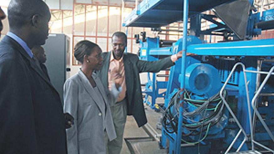 Information Minister Louise Mushikiwabo inspects the installation works of the new state-of-the-art printery in Gikondo yesterday. (Photo J Mbanda).