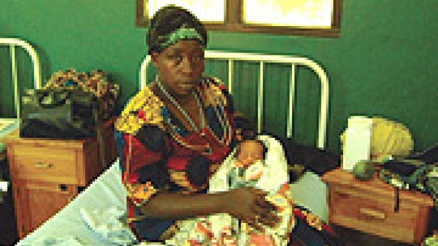 Nyiramana cuddling her baby in Gisenyi Hospital following her evacuation from the DRC jungles. (Photo Byline).