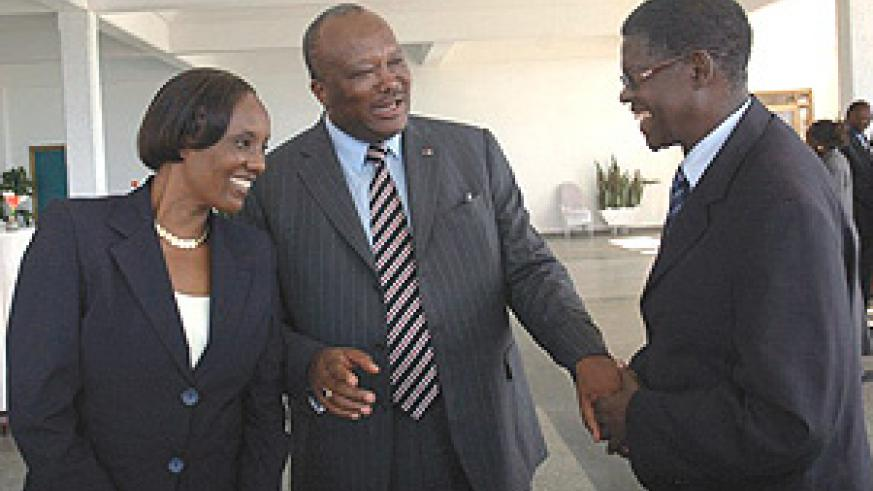 Rose Mukantabana and Christian Kaboré  share a light moment with Deputy Speaker Denis Polisi. (Photo / J. Mbanda).