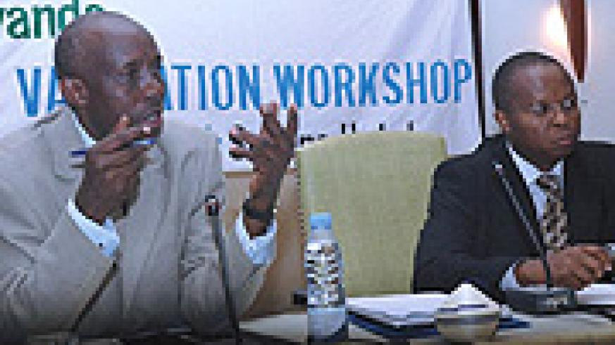 Charles Karake and Wachira Maina, one of the experts who prepared the Skills Audit Report at the workshop yesterday. (Photo / J. Mbanda).