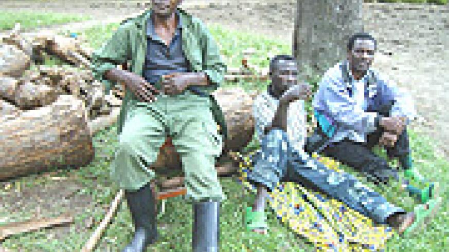 (L-R): FDLR's Capt Silvestre Mwizerwa, Corporal Karasanyi Bimenyimana and S. Sgt Joseph Libakare after surrendering. (Courtesy Photo).