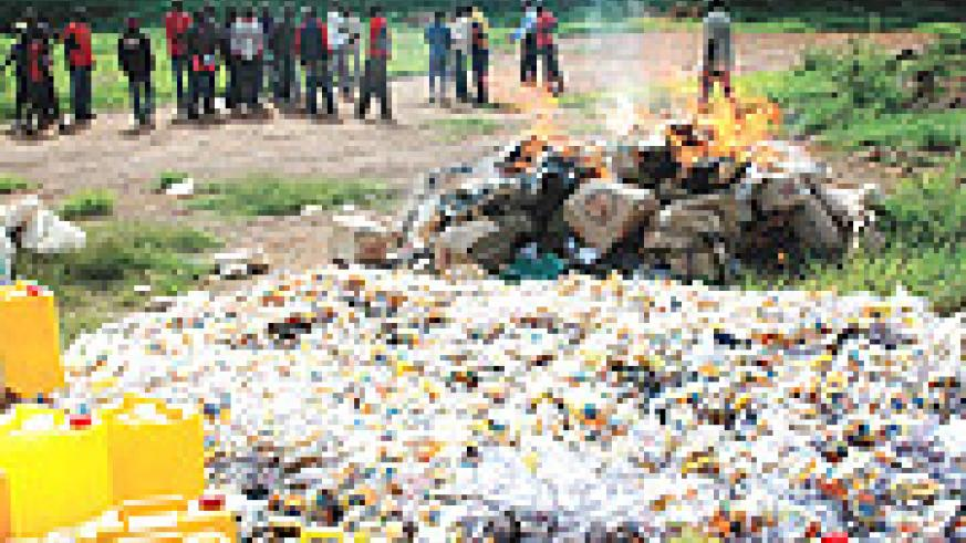 Residents of Remera witness police setting ablaze narcotics that were seized in Gasabo District during the festive season yesterday. (Photo GBarya)