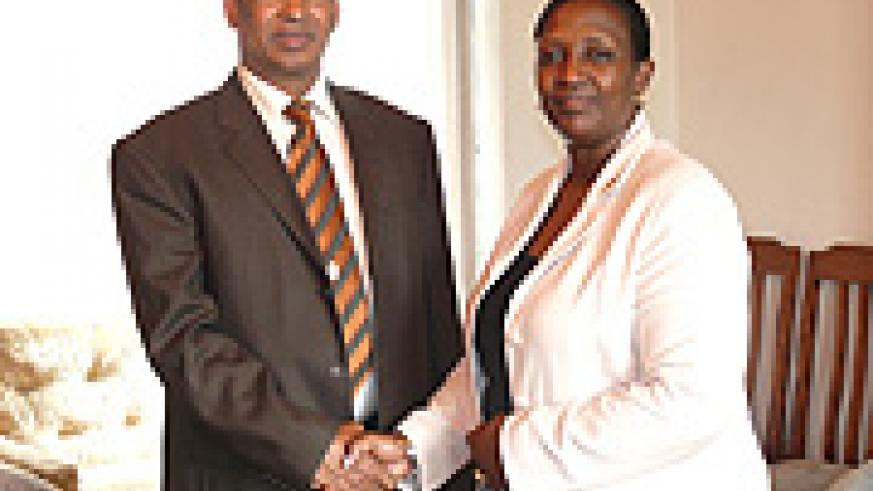 WFP Country Director Abdoulaye Balde and Minister of Foreign Affairs Rosemary Museminali after the former presented his credentials at the Foreign Affairs Ministry. (Courtsey Photo).