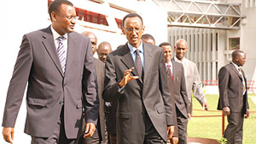 President Kagame with EALA Speaker Abdirahin Abdi at the EAC headquarters at the Arusha International Conference Centre yesterday. (Courtesy Photo).