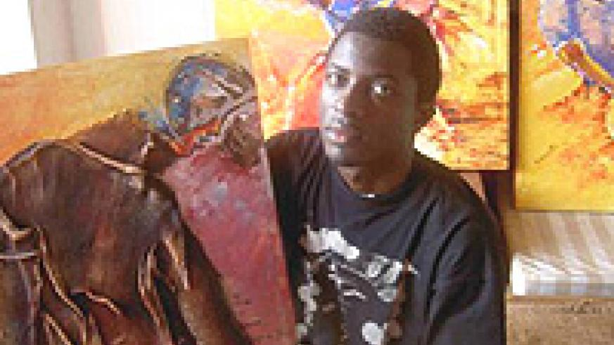 Collin Sekajugo the founder and director of Ivuka Arts Kigali and RwaMakondera, displaying one of his art pieces. (File photo).