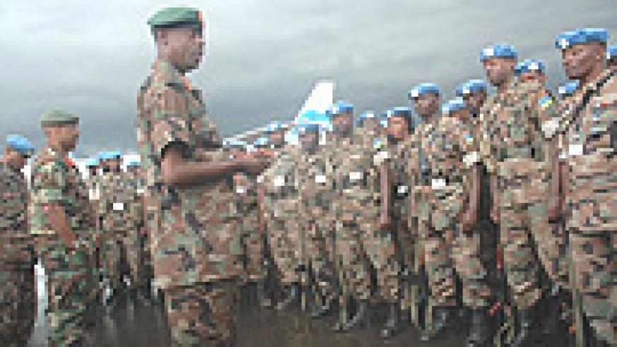 RDF Chief of Defence Staff, General James Kabarebe addresses  troops on their arrival at Kigali International Airport from Darfur. (Photo File).