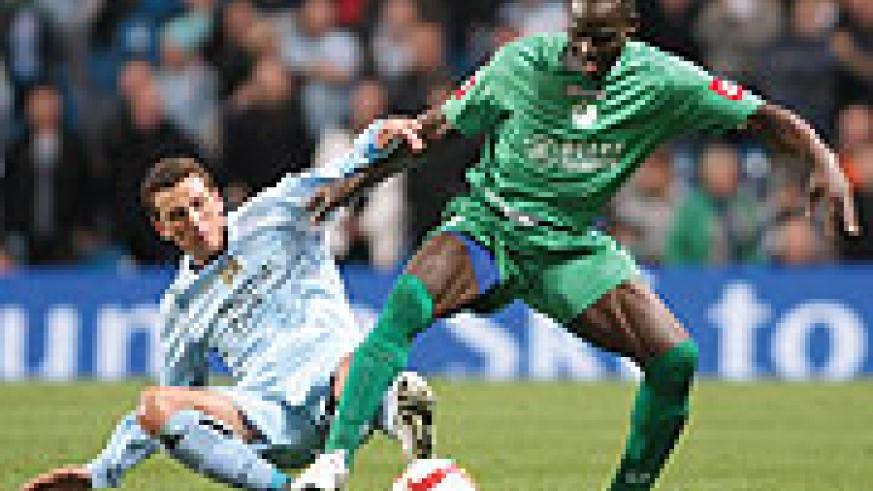 Rwanda's Hamad Ndikumana in action during last year's Uefa Cup tie between AC Omonio and Manchester City. The veteran defender is among the Europe-based pros summoned to beef up the Amavubi team.