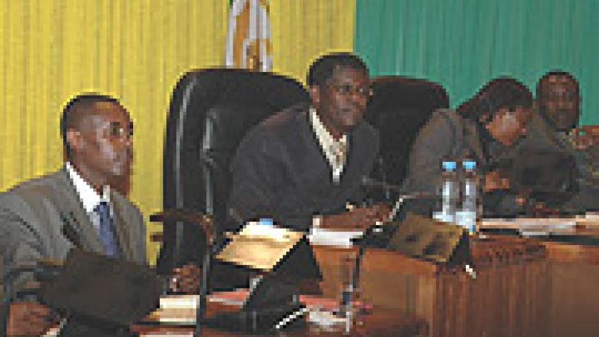 CNLG boss J.D Mucyo (L) before the parliamentary session yesterday. (Photo/ G. Barya).