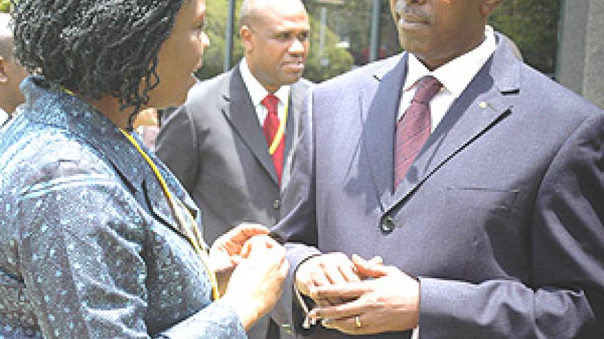 Prime Minister Bernard Makuza chats with WB Country Director Victoria Kwakwa after opening the  national electricity access roundtable yesterday. (Photo/ G.Barya).