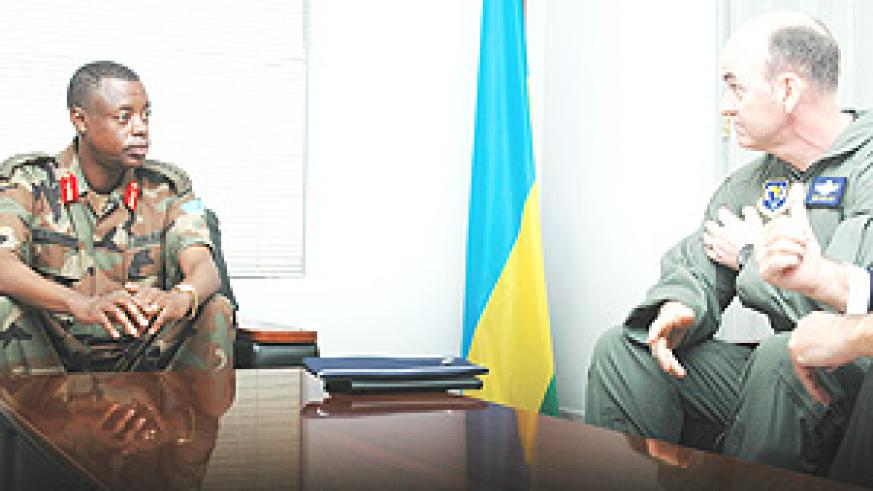 The Chief of Defence Staff, General James Kabarebe  having talks with Brig Gen Michael Callan yesterday. (Photo GBarya).