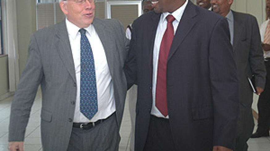 James Musoni and David MacRae after signing of the MoU at MINECOFIN yesterday. (Photo/ J. Mbanda).