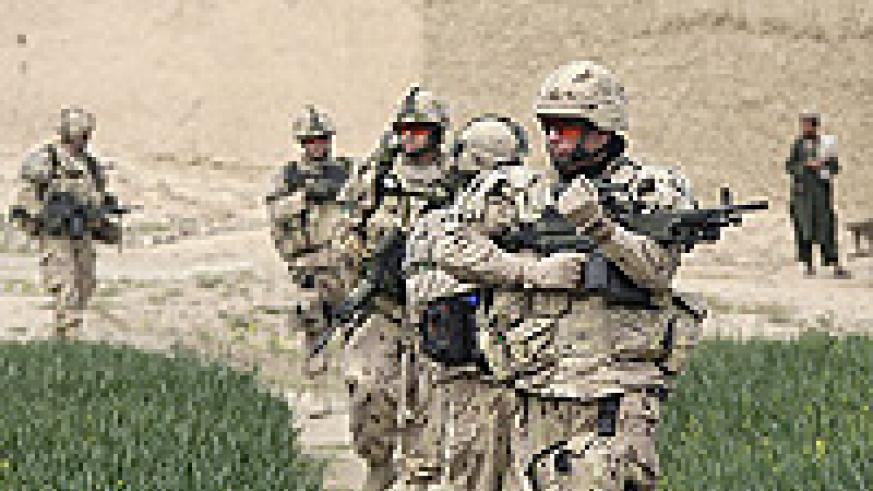 Canadian soldiers from the NATO-led coalition patrol a village in the Taliban stronghold of Arghandab district in Kandahar province, southern Afghanistan.