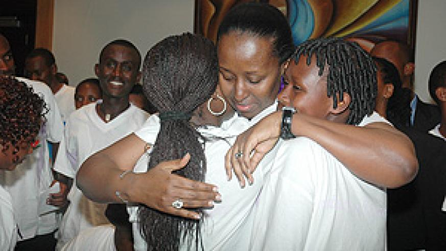First Lady Jeannette Kagame consoles two young Genocide survivors at a  meeting organised by Imbuto Foundation. (Photo/ J. Mbanda).