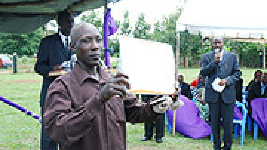 Geoffrey Kasumba displays the certificate of appreciation he received for his efforts. (Photo/ B. Namata).