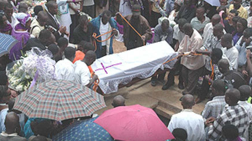 Remains of Genocide victims from Kicukiro District  being lowered into a  grave at Gisozi Memorial Centre yesterday. (Photo G.Barya).
