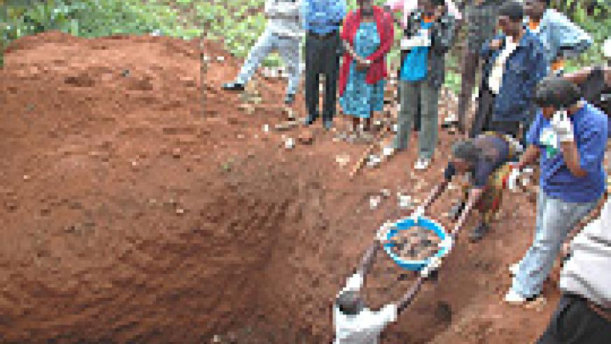 Residents of Nyamirambo witness as the remains of Genocide Victims are exhumed  at St Andre' yesterday. (Photo/ J. Mbanda).