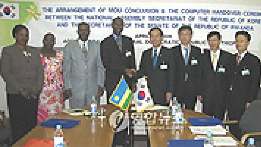 Senate PS Sosthene Cyitatire (4th L) shaking hands with his South Korean counterpart after the signing. (Courtsey photo).