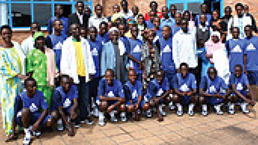 NEW BEGINNING: Rwanda Football Academy's selected players pose for a group with their parents at the academy premises yesterday.