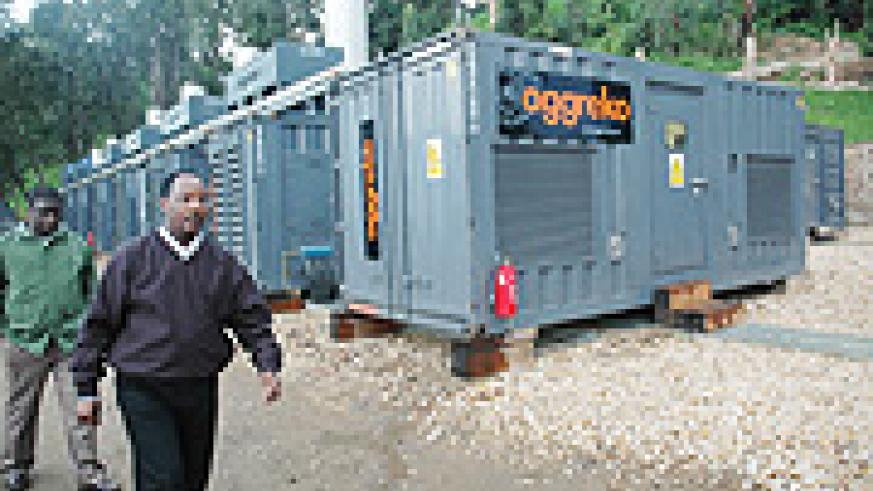 Minister Albert Butare walks past the Aggreko generators last year. (File Photo).
