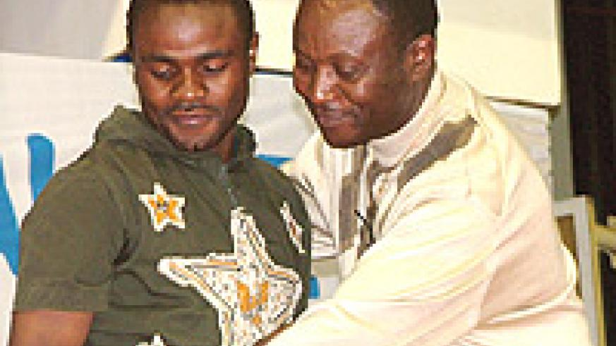 TWO WRONGS DON'T MAKE A RIGHT:  Rayon Sport coach Raoul Shungu (R) shares a moment with striker Abedi Mulenda. Shungu is under-fire for his role in signing expensive flops. He tapped Mulenda from Atraco, something that landed the striker in trouble with F