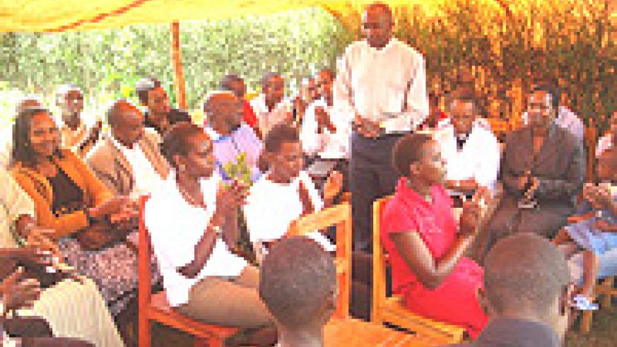 Rev. Canon Peter Twahirwa gives a devotional to the orphans.