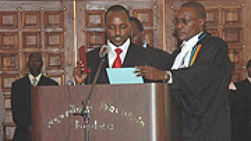 Alloys Mutabingwa taking oath following his appointment as EAC Deputy Secretary General at the Summit in Arusha. (PPU Photo).