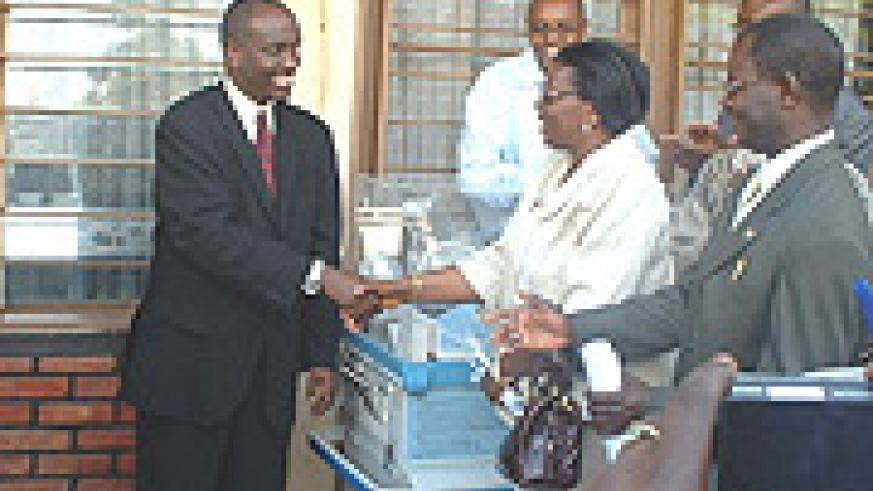 Health Minister, Dr. Richard Sezibera shakes hands with Madame Therese Zeba the UNFPA Resident Representative. (Courtsey Photo).
