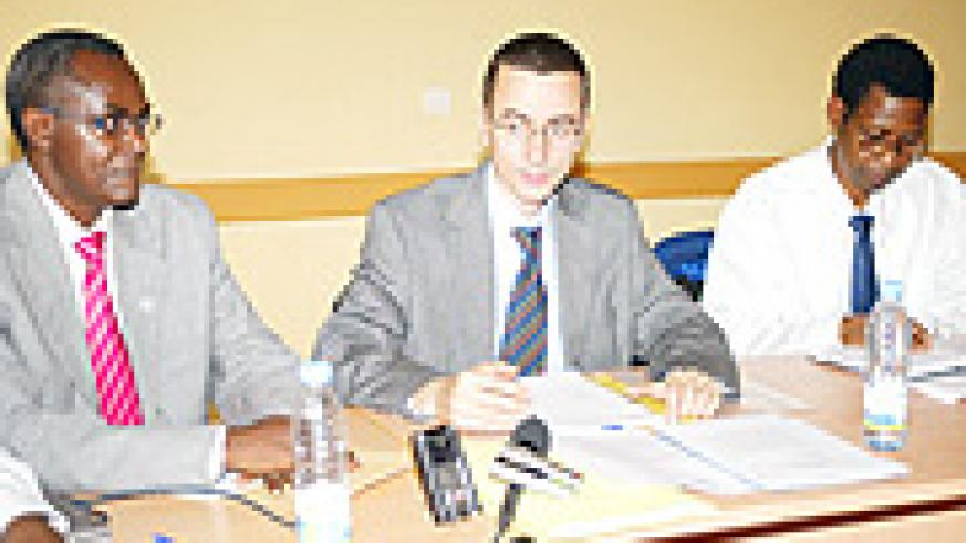Prof. Michael Kramer the Director General of Trac Plus (centre) and Miinistry of Health officials discuss the swine flu.