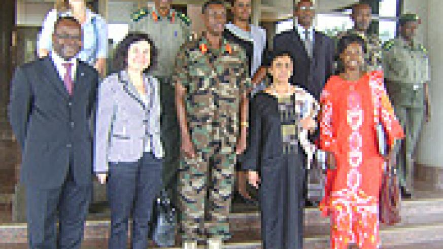 Gen. James Kabarebe and Ines Alberdi  with other officials pose for a photo after their meeting at MINADEF headquarters on Wednesday. (Photo/ R. Mugabe).