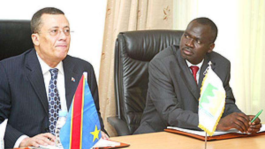 DRC Minister Jose B .Endundo with Environment and Natural Resources Minister, Stanislas Kamanzi, addressing members of the press yesterday. (Photo/ G.Barya).