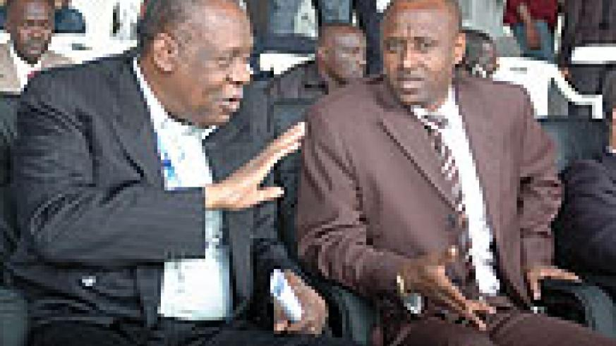 PROPOSED: Ferwafa boss Brig. Gen. Jean Bosco Kazura (R) seen here with Caf chief Issa Hayatou during the African Youth Championships in Kigali. Kazura has confirmed the friendly match with Malawi but is not sure of the date. (File photo)