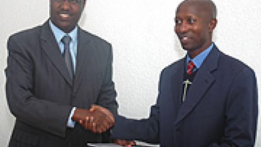 Protais Mitali hands over to Fazil Harelimana after the latter was elected as FPPR Spokesperson. (Photo/ J. Mbanda).