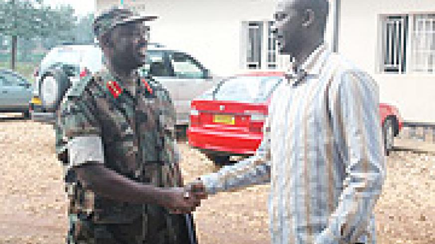 Col. Firmin  Bayingana greets a friend recently. (File Photo).