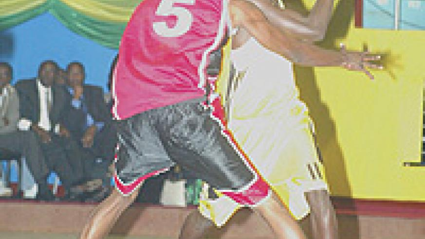 Former Marine captain Fiston Muhire (with the ball) weighed in 15 points for CSK. (File photo).