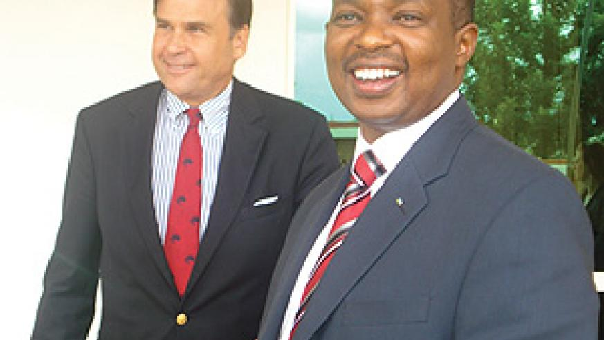 Minister Vincent Karega with the US ambassador to Rwanda Stuart Symington after the presentation. (Photo/ M. Gahigi)