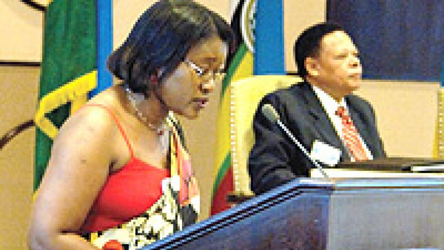 Minister for East African affairs Monique Mukaruliza delivering her opening remarks during a recent EAC retreat (File Photo)