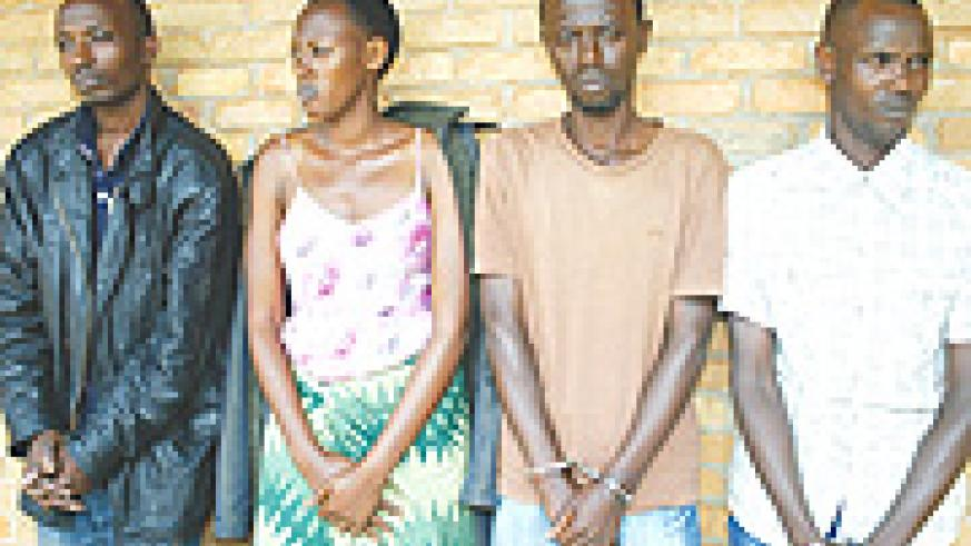 Emmanuel Dusingizimana, Josélyne Kayitesi, Kamuhanda and Uwizeyimana at Kicukiro Police post Yesterday. The quartet is accused of murder. (Photo GBarya).