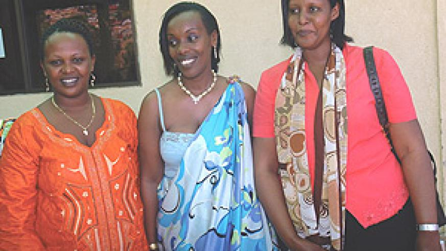 The new National Women Council (NWC) Chairperson Dr Diane Gashumba (C), her predecessor Oda Gasinzigwa (R) and the new Secretary, Flavia Sarafina, after the election. (Photo/ J. Mbanda).
