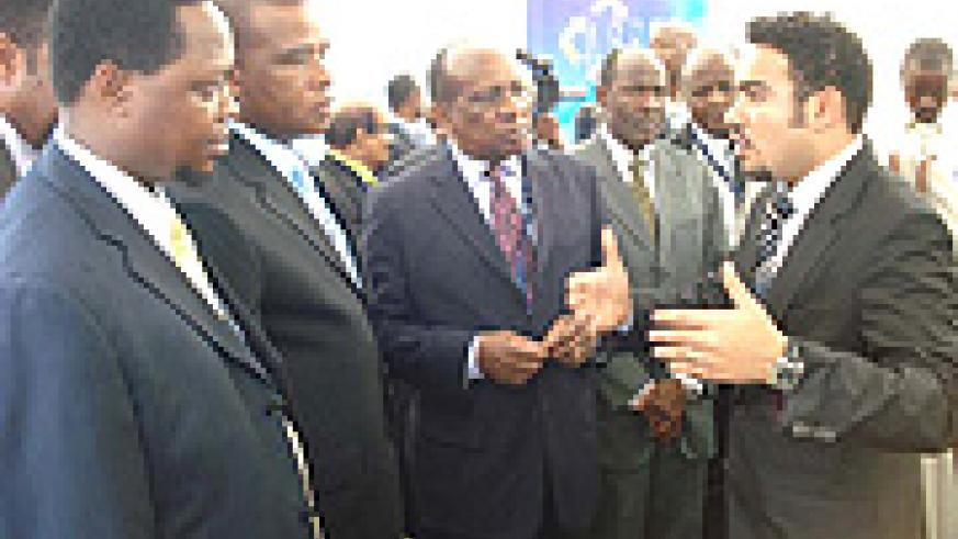 L-R: Jean Claude Nsengiyumva, the EAC Deputy Secretary General (Productive and Social Sectors), William Ngeleja, Tanzania's Minister for Energy and Minerals and Reginald Mengi,Chairman, East African Business Council listens to an energy investor during th